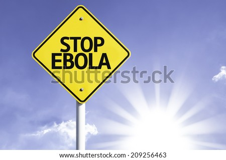 Stop Ebola road sign with sun background