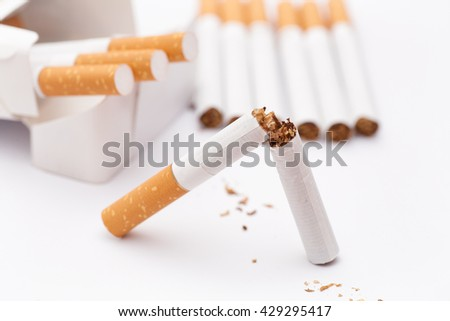 Stop Smoking! Conceptual image. Broken cigarette and pack of cigarettes. Close up.