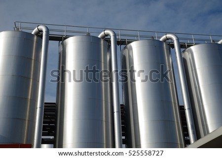 Storage silos contain cleaning chemicals for a milk factory