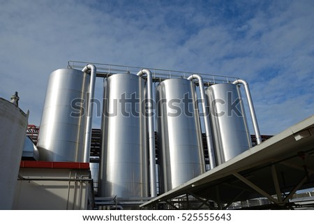 storage silos for cleaning chemicals at a milk factory