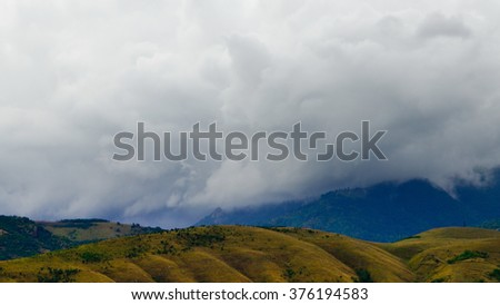 Storm clouds over mountain range