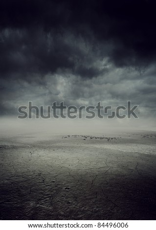 storm landscape with dry cracked land