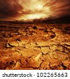 Stormy sky over desert. - stock photo