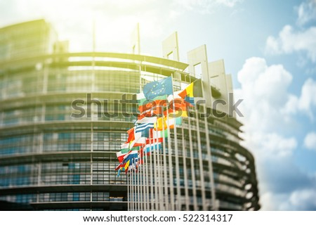 STRASBURG, FRANCE - JUN 1, 2012: Flags in front of the European Parliament, Flags in front of the European Parliament, Strasbourg, Alsace, France.  Tilt shift lens used to accent the flags