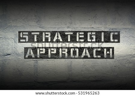 strategic approach stencil print on the grunge white brick wall