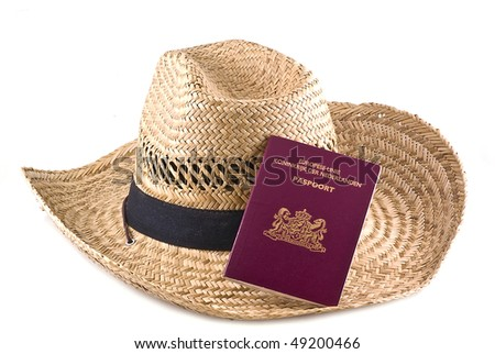 Straw hat with passport, isolated on a white background.