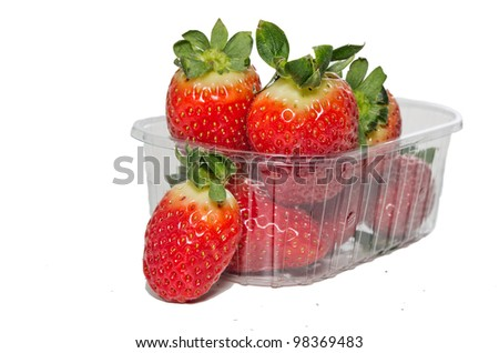 Strawberries in plastic box on white background.