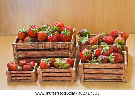 Strawberries in small boxes