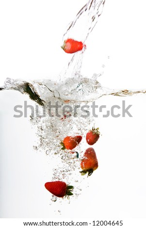 Strawberries in water floating and bubbling