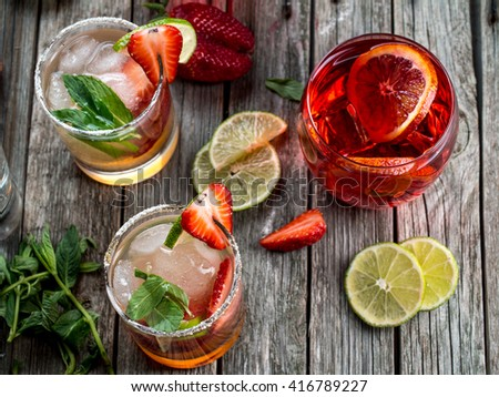 Strawberry blood orange rum punch, strawberry mojito and other cocktails