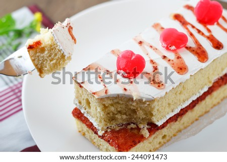 Strawberry cake with heart candies for sweet valentines.