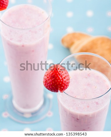 strawberry cocktail on blue background