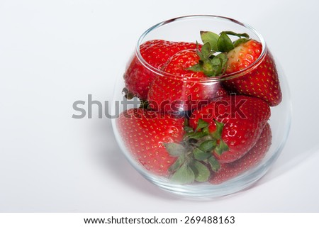 strawberry in glass isolated on white background