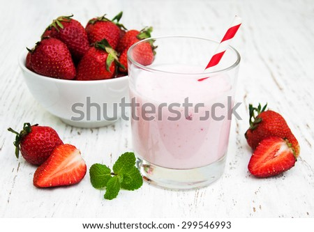Strawberry yogurt with fresh strawberries on a wooden background