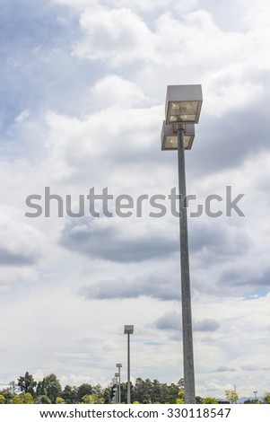 street light, modern style with a cloudy sky.
