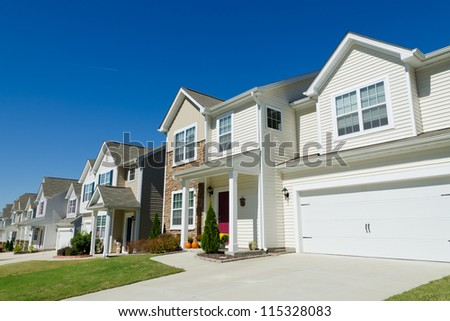 Street of residential houses with vinyl siding