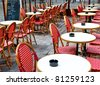 Street view of a Cafe terrace with empty tables and chairs,paris France - stock photo