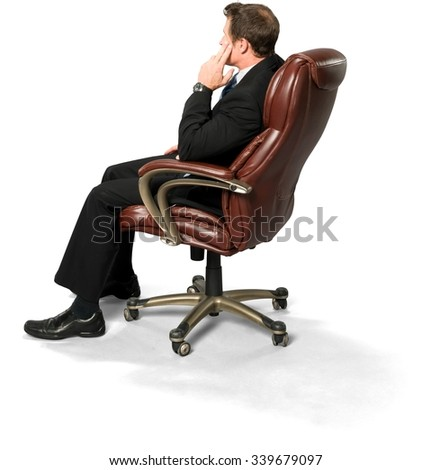 stressed caucasian man with short medium blond hair in business formal outfit with hands on thighs - Office Chair For Short Person
