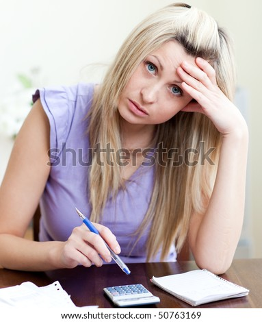 Stressed woman having financial problems in a living-room