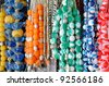 Strings of worry beads for sale in a market in Greece. - stock photo