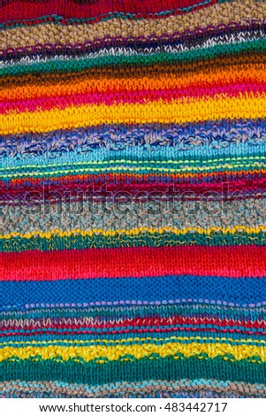 striped colorful wool texture handmade patten closeup macro blue red green yellow orange purple beige brown