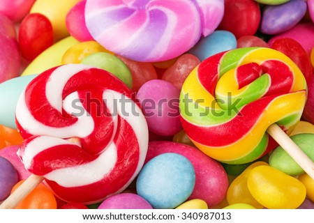 striped lollipops on multicolor confectionery