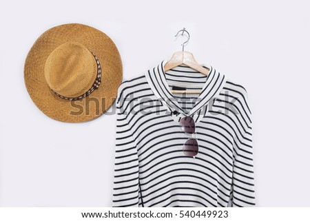 Striped shirt on wooden clothes with hat rack isolated