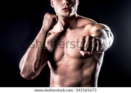 strong male in fighting position showing fist