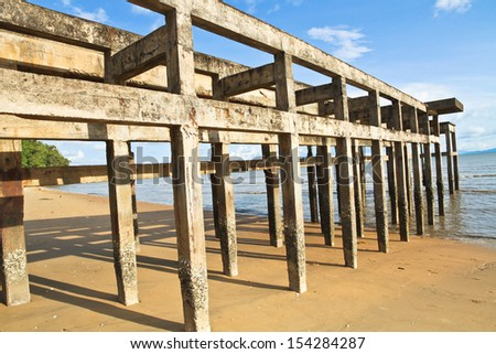 Structure of old port under blue sky