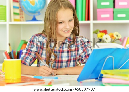 student girl  doing homework