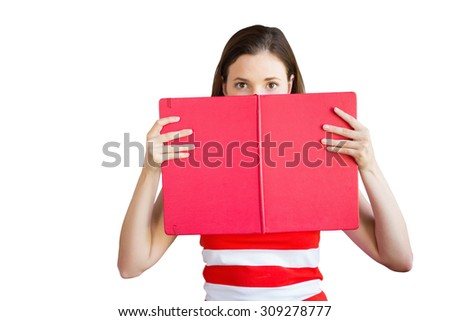 Student holding book over face against white background with vignette