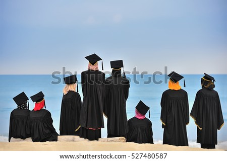 student in cap and gown or ropes. graduate from university celebrating degree by view of the sea