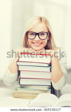 student with stack of books