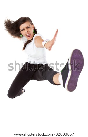 Studio isolated. Dancing woman with brown long hair and happy smiling facial expression posing.