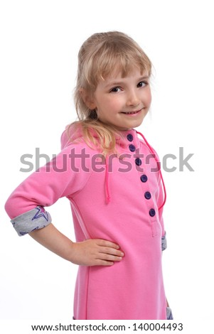Studio photo of adorable little girl in pink dress