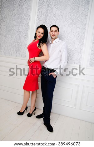 studio photo of beautiful impassioned couple, wears elegant clothes,