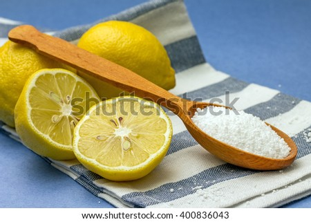 Studio photo of citric acid and lemons, on blue background