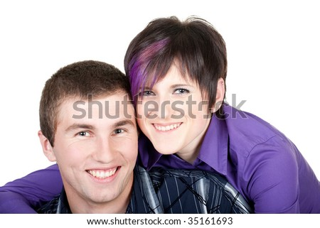 studio portrait of a happy young couple