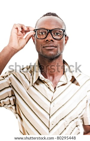 Studio portrait of cool black young man with black glasses and striped retro 70s shirt isolated on white background.