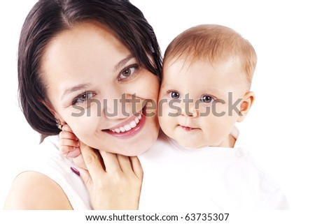 Studio portrait of loving young mother hugging her child