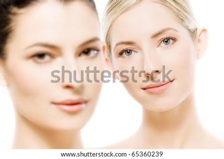 studio portrait of two young beautiful women, selective focus