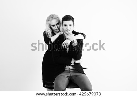Studio portrait of young stylish beautiful couple.