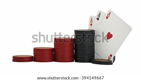 Studio shot of a three aces with red and black poker chips, stacked in ascending order, on white background.
