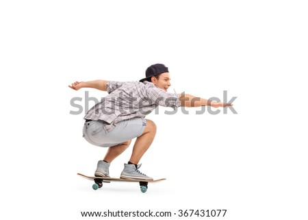 Studio shot of a young man riding a skateboard isolated on white background
