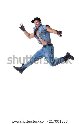 Studio shot of cheerful bearded man posing in jump