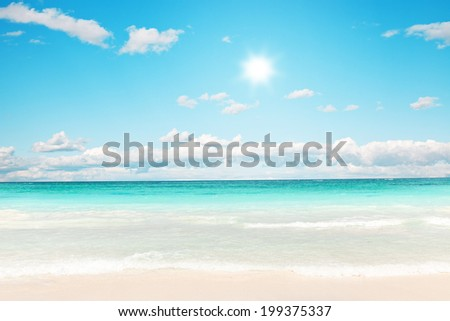 Stunning Caribbean beach with transparent water against sunlight