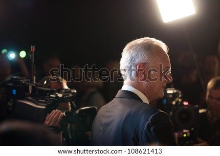STUTTGART, GERMANY - JULY 25: Harald Schmidt, the most famous German talkmaster, is interviewing guests at the premiere of Mozarts opera Don Giovanni in Stuttgart on July 25, 2012.