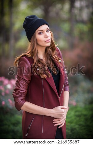 Style redhead girl at beautiful autumn alley