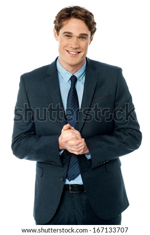 Stylish businessman posing with hands clasped