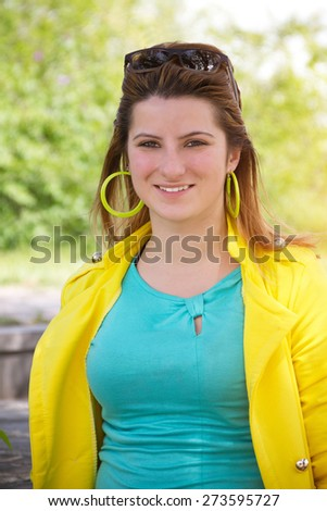 Stylish girl in bright clothes smiles